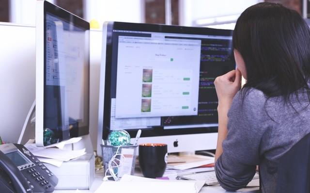 Working Woman at Dual Monitors